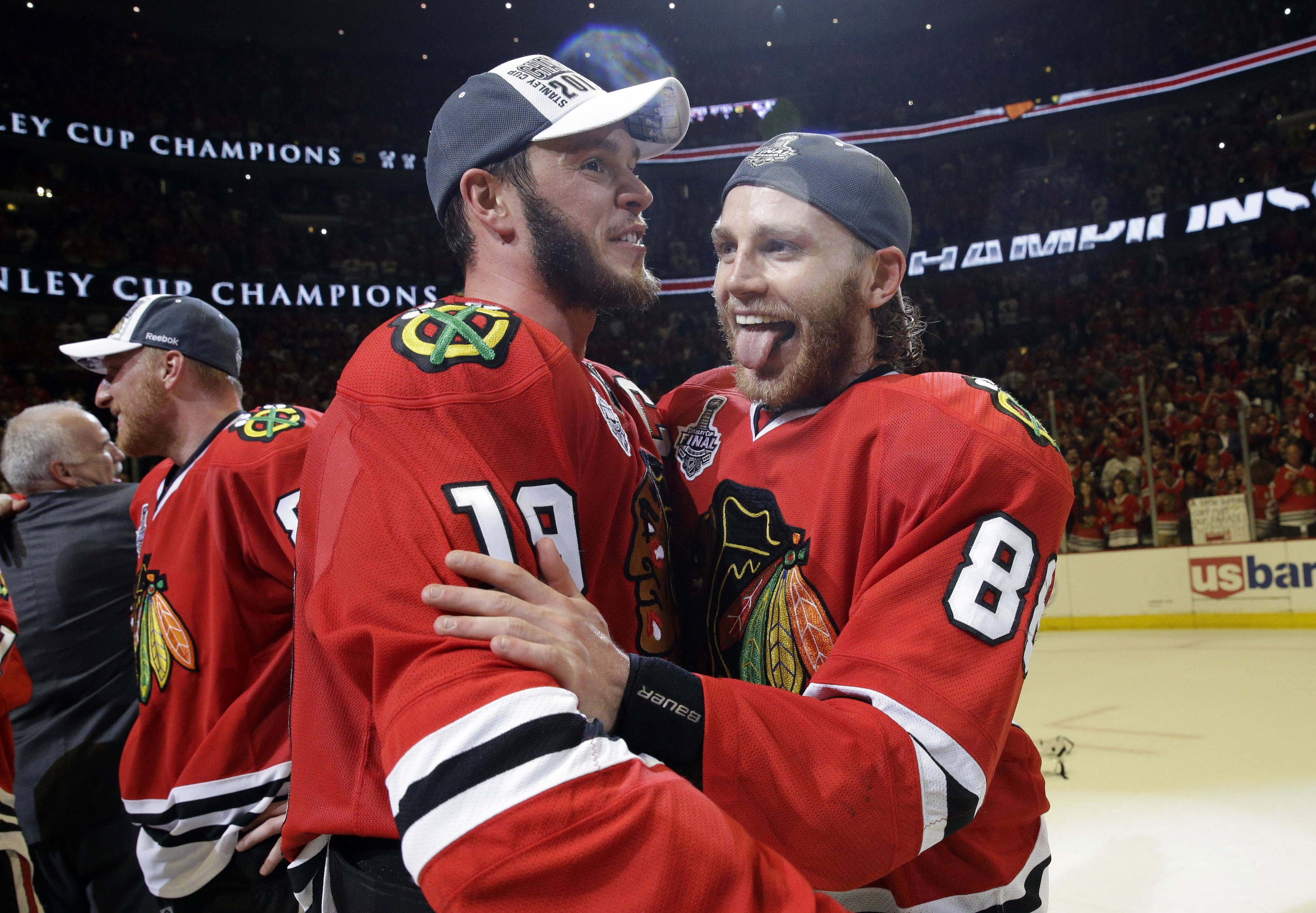 Blackhawks' Jonathan Toews and Patrick Kane celebrate after defeating the Tampa Bay Lightning in Game 6 of the NHL hockey Stanley Cup Final series on Monday, June 15, 2015, in Chicago. The Blackhawks defeated the Lightning 2-0 to win the series 4-2.The Blackhawks got back to work Friday as training camp opened at the United Center. The big question is, do they have what it takes to compete for another Stanley Cup?