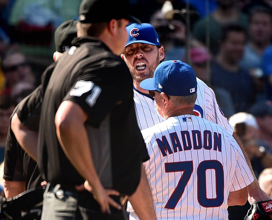 Chicago Cubs starting pitcher John Lackey (41) is ejected by home plate umpire Jordan Baker (71) in the fifth inning of Friday's game against the St. Louis Cardinals at Wrigley Field. Catcher Willson Contreras also was ejected by Baker.