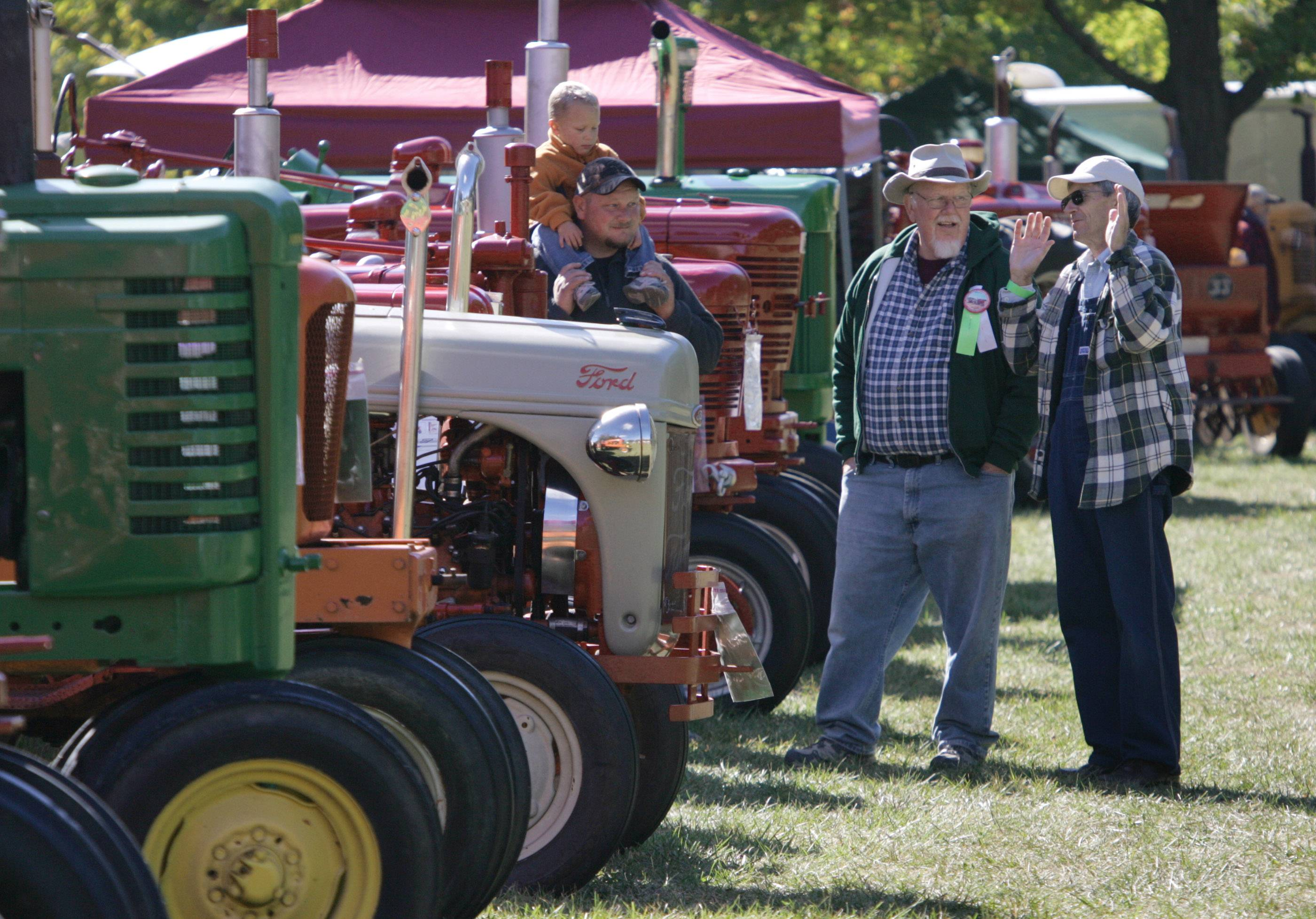 Attendees discuss the tractors on display at a previous Lake County Farm Heritage Festival. Formerly held at Lakewood Forest Preserve, the event moves to the Lake County Fairgrounds in Grayslake this year, from 10 a.m. to 7 p.m. Sept. 23 and 10 a.m. to 5 p.m. Sept. 24.