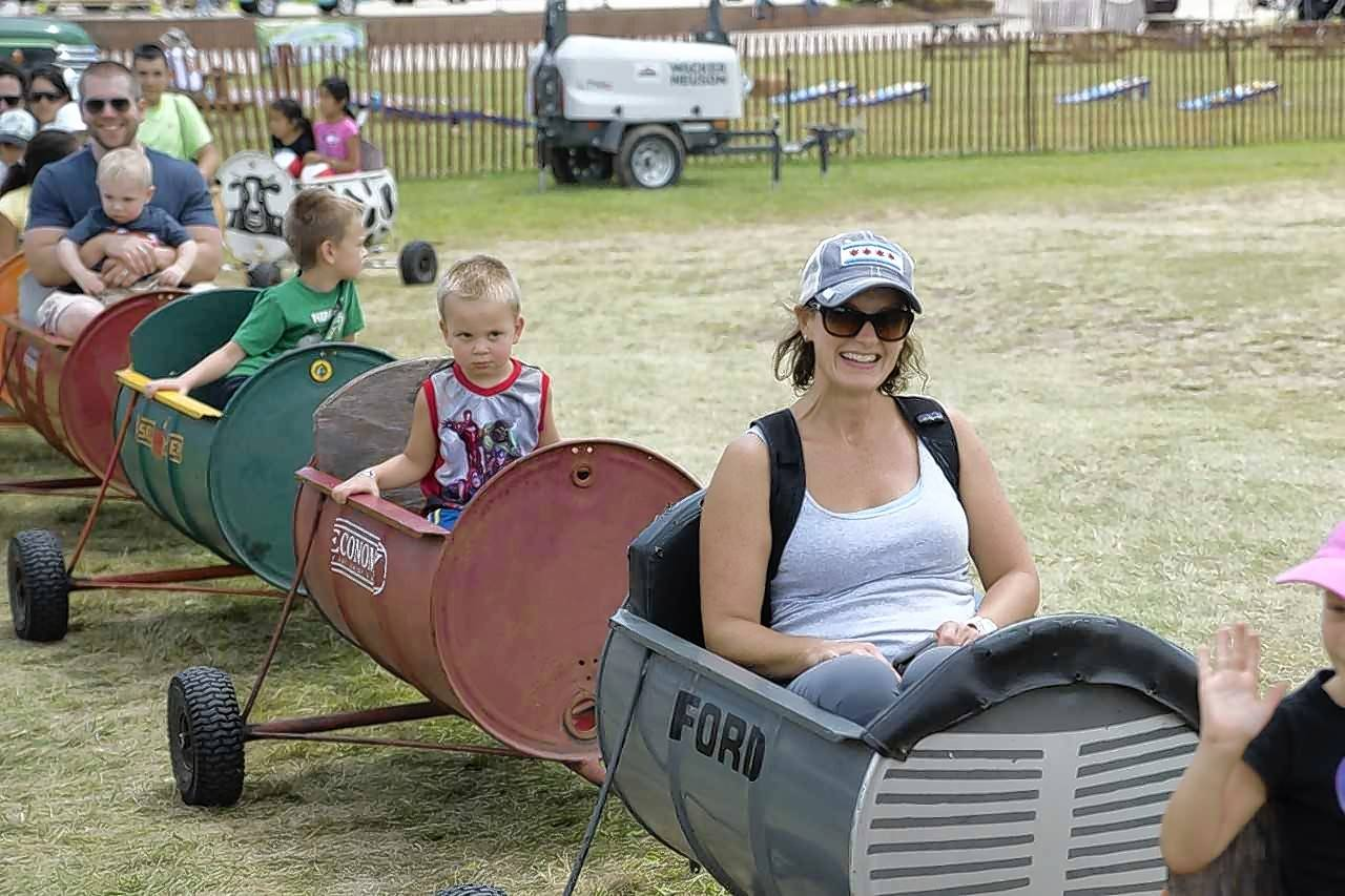Festivalgoers ride the barrel train at a previous Lake County Farm Heritage Festival. Other activities at this year's event will include hayrides, rope-making, a petting zoo and more.