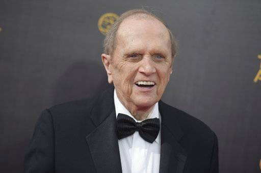 "FILE - In this Sept. 10, 2016 file photo, Bob Newhart arrives at night one of the Creative Arts Emmy Awards at the Microsoft Theater in Los Angeles. Newhart is looking forward to a TV marathon that will mark the 45th anniversary of his 1970s sitcom. But that doesn't mean he'll be binge-watching ""The Bob Newhart Show"" this weekend. As the droll comedian put it, he knows how most of the episodes end. The Decades channel will air 84 back-to-back episodes of Newhart's sitcom starting Saturday, Sept. 16, 2017 and ending at Monday, Sept. 18. (Photo by Richard Shotwell/Invision/AP, File)"