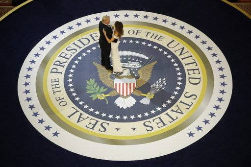 "FILE - In this Jan. 20, 2017, file photo, President Donald Trump dances with first lady Melania Trump, at The Salute To Our Armed Services Inaugural Ball in Washington. When President Donald Trump's inaugural committee raised an unprecedented $107 million for a ceremony that officials promised would be ""workmanlike,� the committee pledged to give leftover funds to charity. Nearly eight months later, the group has helped pay for redecorating at the White House and the vice president's residence in Washington. But nothing has gone to charity. (AP Photo/Evan Vucci, File)"