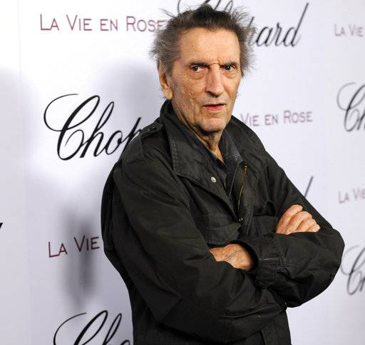 FILE - In this Feb. 4, 2008, file photo, actor Harry Dean Stanton arrives at a celebration for actress Marion Cotillard in West Hollywood, Calif. Legendary character actor Stanton has died at age 91. Stanton's agent John S. Kelly says the actor died Friday afternoon, Sept. 15, 2017, at Cedars-Sinai Medical Center in Los Angeles. Kelly said Stanton died of natural causes, but gave no further details. (AP Photo/Chris Pizzello, File)
