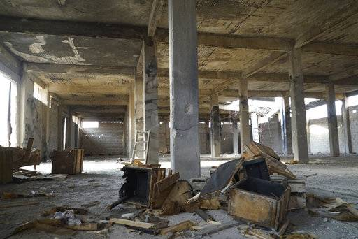 An inside view of a destroyed tank bomb factory operated by Islamic State militants in the town of Okeirbat, the northern Hama province, Syria, Friday, Sept. 15, 2017. Syrian government forces recaptured the strategic town in the northern Hama province earlier this month. (AP Photo/Nataliya Vasilyeva)
