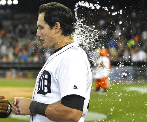 Detroit Tigers' Mikie Mahtook (15) is doused by a cup of water thrown by relief pitcher Warwick Saupold after the team's baseball game against the Chicago White Sox, Friday, Sept. 15, 2017, in Detroit. The Tigers won 3-2. (AP Photo/Jose Juarez)