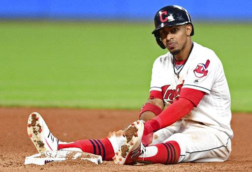 Cleveland Indians' Francisco Lindor sits near second base after being forced out in a double play in the seventh inning of a baseball game against the Kansas City Royals, Friday, Sept. 15, 2017, in Cleveland. (AP Photo/David Dermer)
