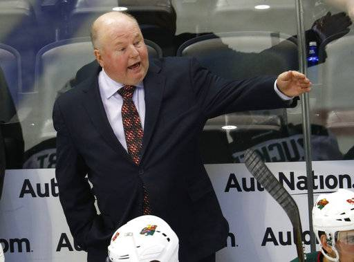 FILE - In this Oct. 4, 2016, file photo, Minnesota Wild head coach Bruce Boudreau directs his players in the second period of an NHL preseason hockey game against the Colorado Avalanche in Denver. The Wild start their second season under Boudreau, with the grueling conditioning test designed to set the tone for the up-tempo style Boudreau wants his team to play. (AP Photo/David Zalubowski, File)