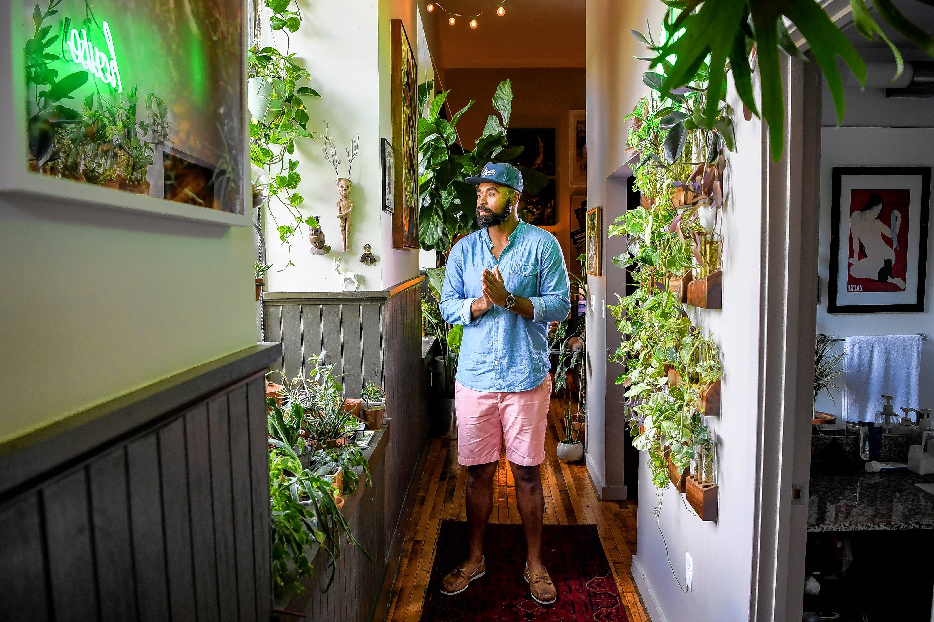 Hilton Carter, 37, has always enjoyed plants. But his Baltimore apartment now holds 180, and it's a perfect example of a growing trend.