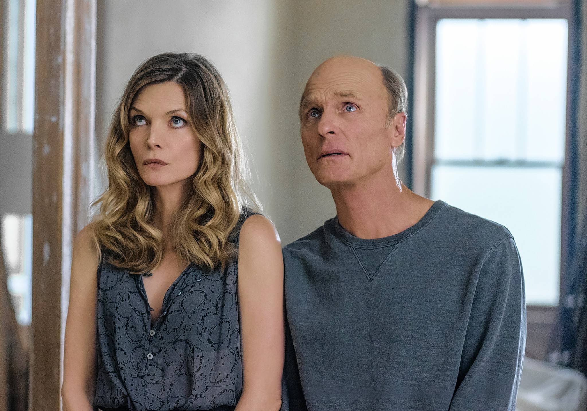 "Woman (Michelle Pfeiffer) and Man (Ed Harris) bring death and mayhem into a couple's quiet existence during Darren Aronofsky's fever dream thriller ""mother!"""