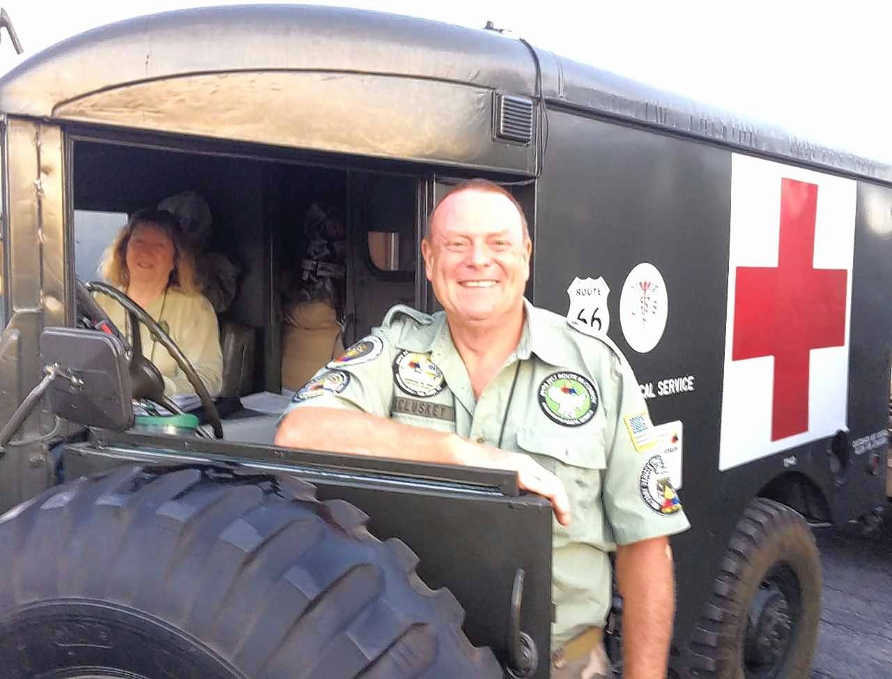 Leading a cross-country convoy of 60 antique military vehicles along U.S. Route 66, Dan and Janine McCluskey of the Military Vehicle Preservation Association keep the pace under 35 mph in their 1964 Dodge M43 ambulance. If it's hot, they pop open the windshield glass.