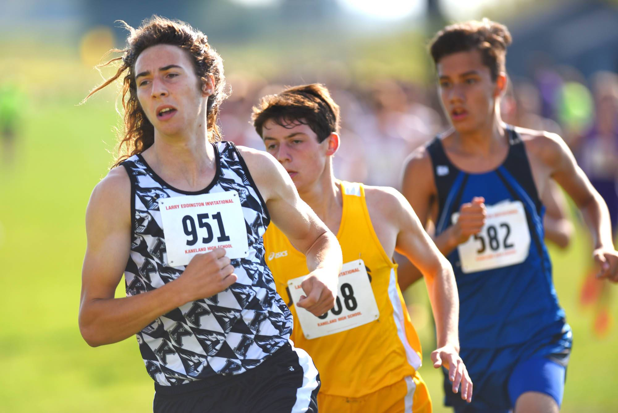 Kaneland's Matthew Richtman leads Jacobs' Zack Albrecht through a turn Saturday at the Eddington Invitational cross country meet at Kaneland High School. They finished first and second.
