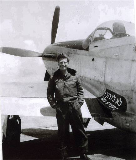 This 1949 photo courtesy of Michael Flint shows his father, Commander Mitchell Flint next to an American P-51 Mustang in Israel. Mitchell Flint, an American aviator who helped form the Israeli Air Force in 1948 and served in Israel's first fighter squadron has died at age 94. Flint, a former US Navy fighter pilot, died Saturday, Sept. 16, 2017, in Los Angeles of natural causes, said his son, Michael Flint. (Michael Flint/Mitchell Flint Collection via AP)