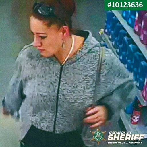 An undated security video image released by The Spokane County Sheriff's Office shows a person of interest in the theft of a purse of a parent who rushed to check on her child following the school shooting at Freeman High School in Rockford, Wash. Authorities say the purse was stolen Wednesday, Sept. 13, 2017, as parents converged on Freeman High School, where a gunman had opened fire, killing one student and injuring three others. (Spokane County Sheriff's Office via AP)