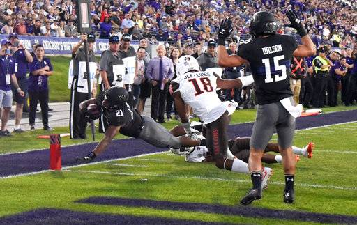Northwestern running back Justin Jackson (21) scores a touchdown against Bowling Green defensive back Cameron Jefferies (18) during the first half of an NCAA college football game in Evanston, Ill., Saturday, Sept. 16, 2017. (AP Photo/Matt Marton)