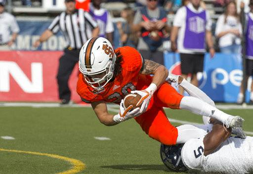Idaho State's Michael Dean, left, dives for more yardage as he is hit by Nevada' Dameon Baber in the first half of an NCAA college football game in Reno, Nev., Saturday, Sept. 16, 2017. (AP Photo/Tom R. Smedes)