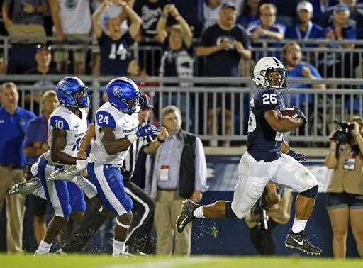 Penn State's Saquon Barkley (26) runs in for a touchdown after a catch against Georgia State during the first half of an NCAA college football game in State College, Pa., Saturday, Sept. 16, 2017. (AP Photo/Chris Knight)