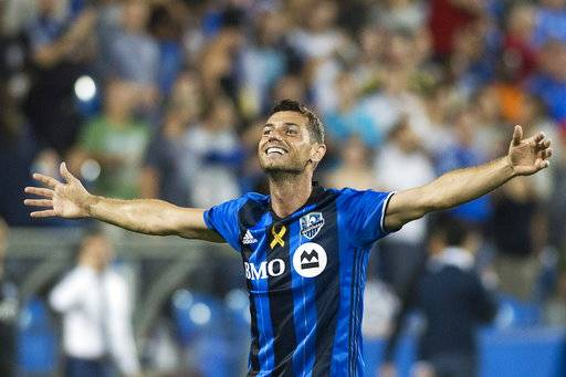 Montreal Impact's Blerim Dzemaili celebrates after scoring against Minnesota United FC during second half MLS soccer action in Montreal, Saturday, Sept. 16, 2017. (Graham Hughes/The Canadian Press via AP)