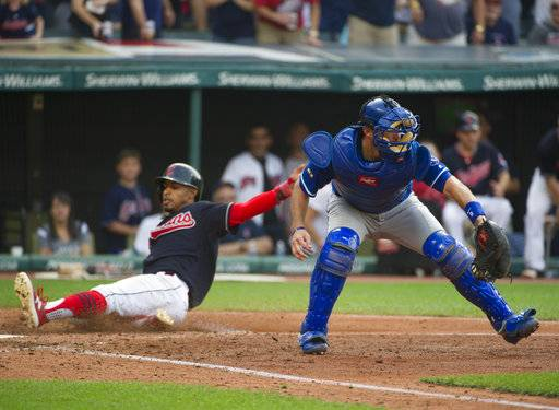 Kansas City Royals' Drew Butera catches the throw to home as Cleveland Indians' Francisco Lindor scores, during a baseball game in Cleveland, Saturday, Sept. 16, 2017. (AP Photo/Phil Long)