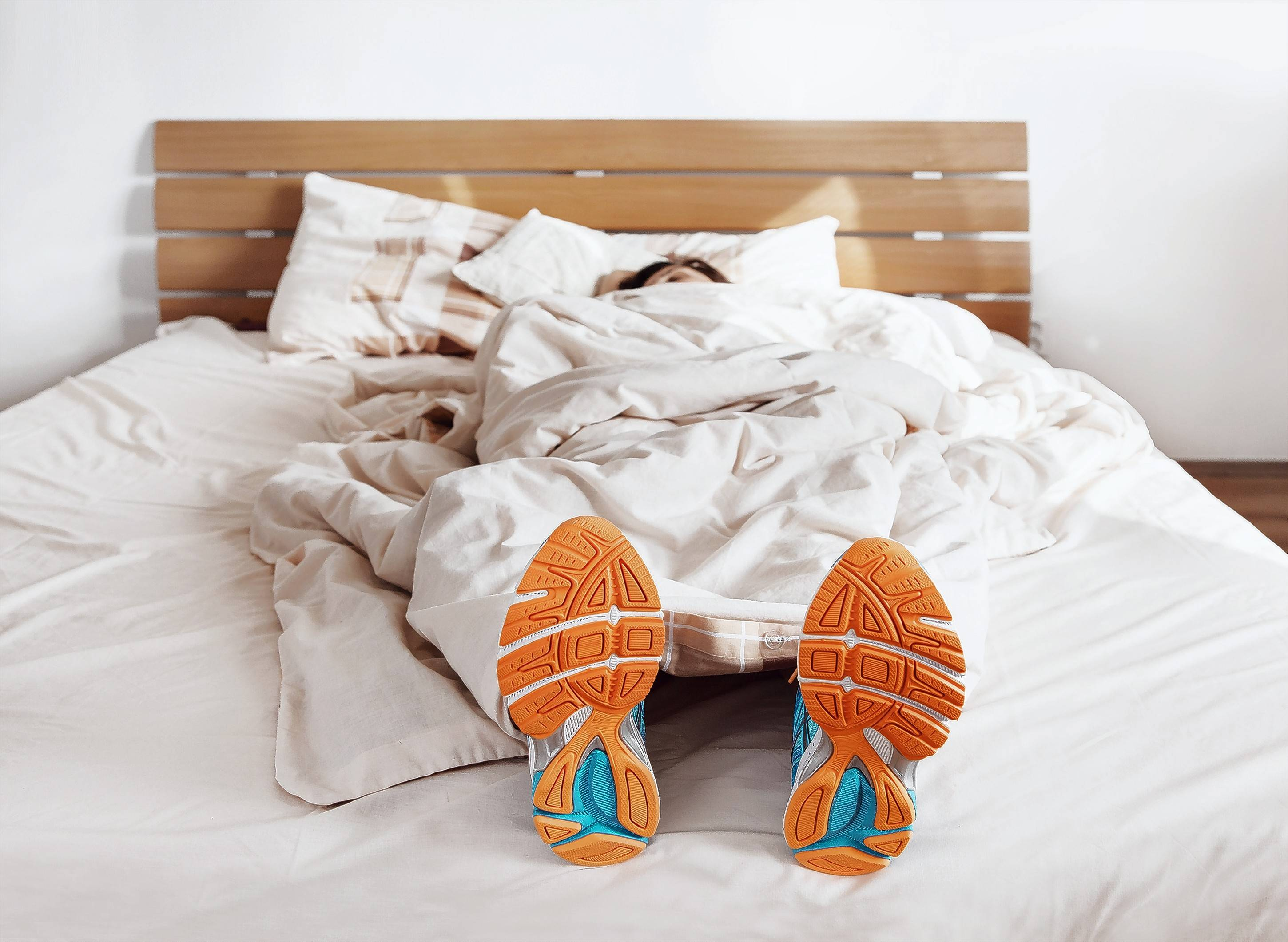 Sleeping with your running shoes on isn't necessary to be ready for early morning exercise, but there are some tips that can help you add morning workouts to your day.
