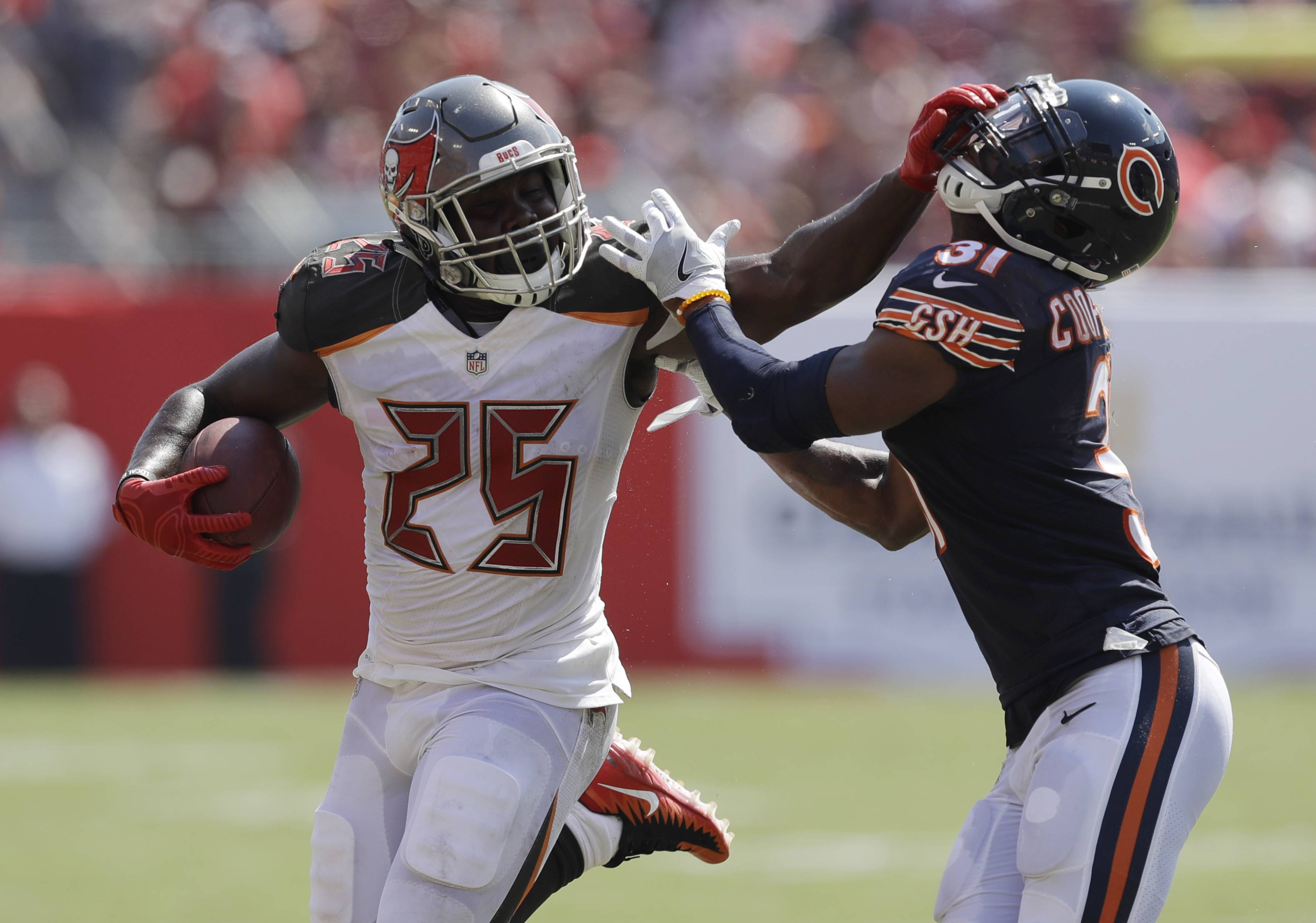 Chicago Bears defensive back Marcus Cooper (31) attempts to stop Tampa Bay Buccaneers running back Peyton Barber (25), during the second half of an NFL football game, Sunday.
