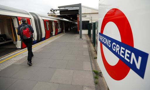 Travellers walk on the platform at Parsons Green tube station following Friday's incident on a tube at Parsons Green Station in London, Sunday, Sept. 17, 2017. A manhunt is under way after an improvised explosive device was detonated on a crowded subway car, injuring at least 29 people. (AP Photo/Frank Augstein)