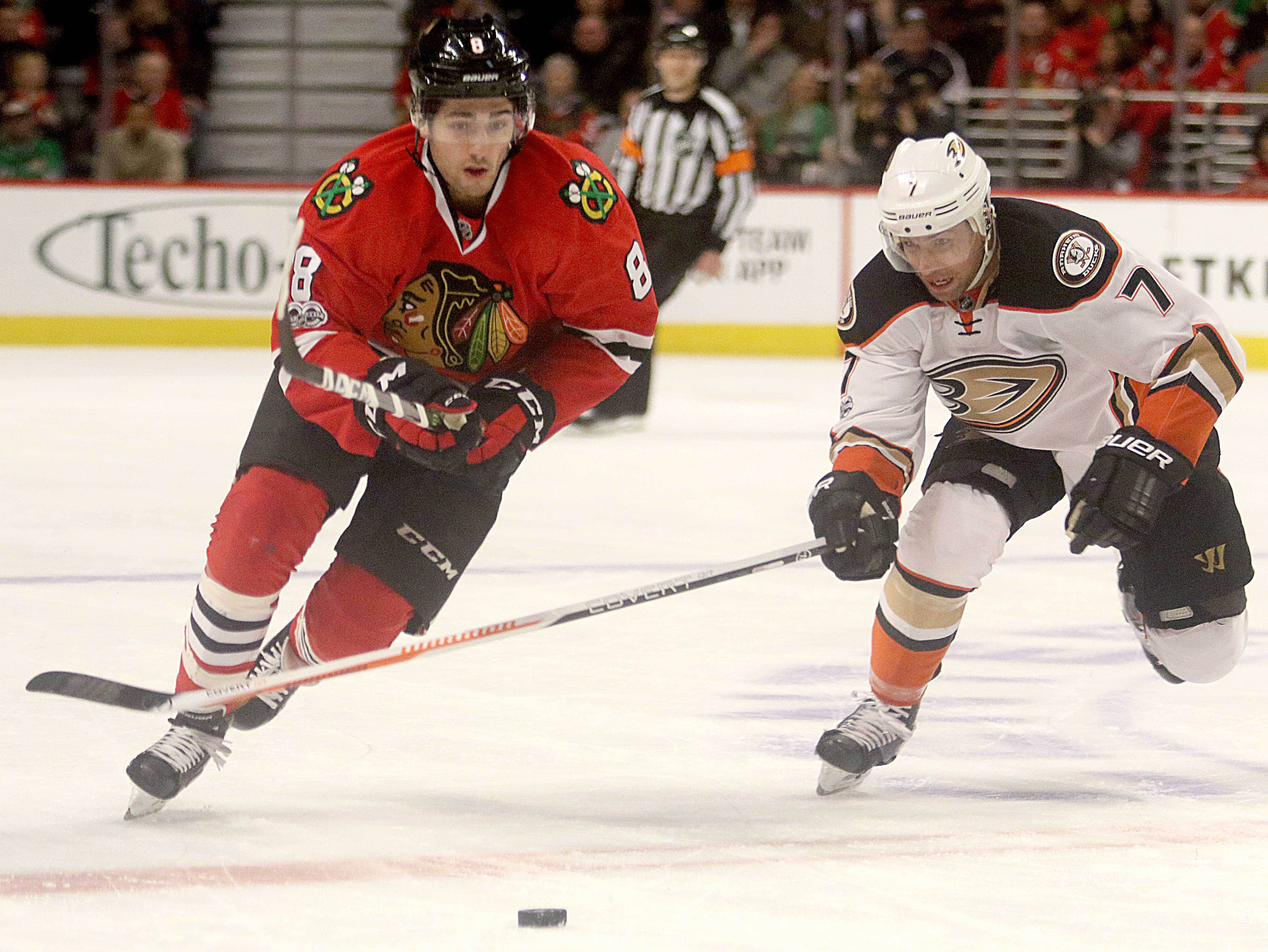 Blackhawks center Nick Schmaltz races Anaheim Ducks left wing Andrew Cogliano for the puck during a game last season. If Schmaltz can center the Blackhawks' second line this season, it would go a long way to giving coach Joel Quenneville's squad a deep, dangerous four-line rotation.