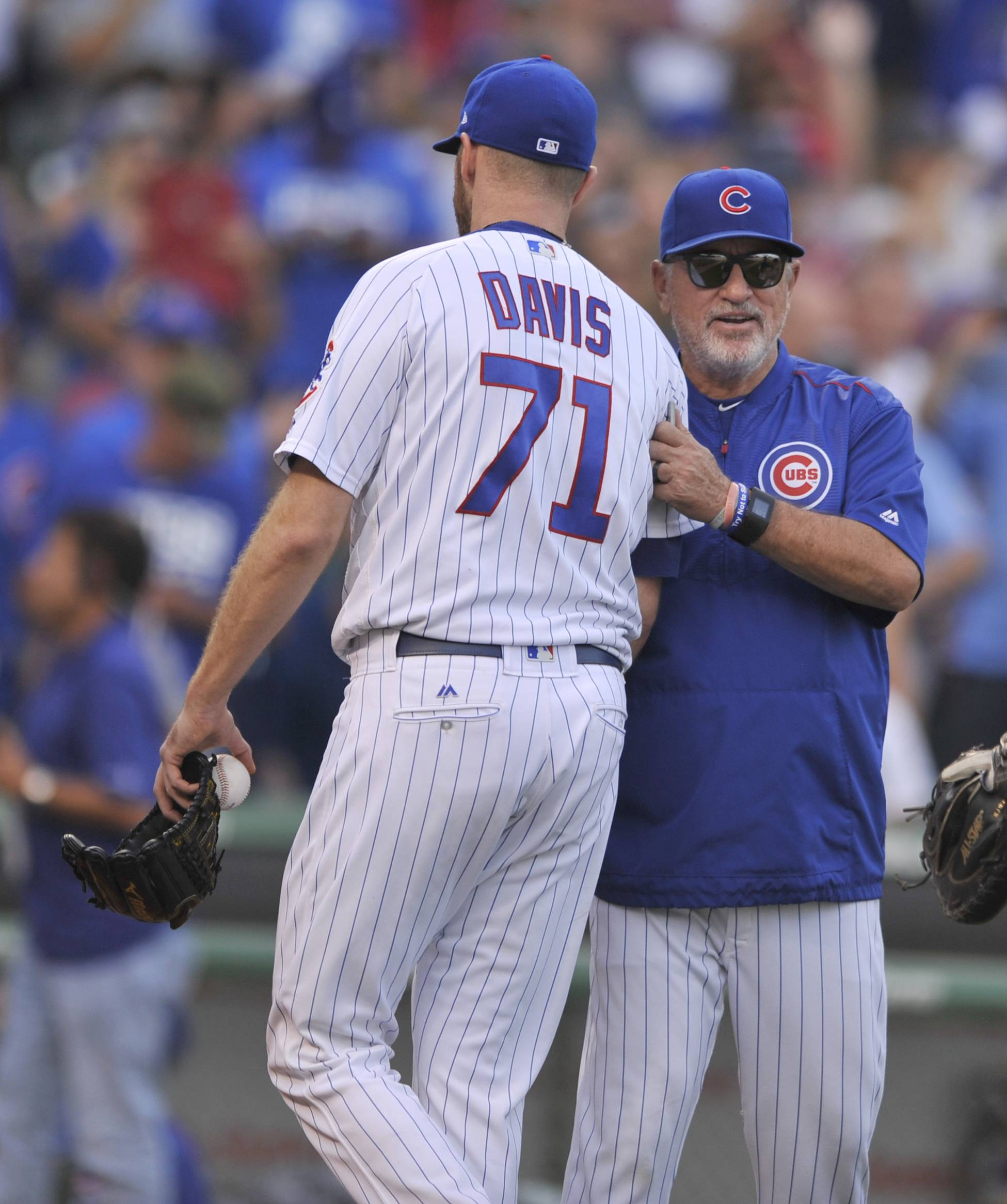 Chicago Cubs closing pitcher Wade Davis (71) celebrates with manager Joe Maddon right, after defeating the St. Louis Cardinals in a baseball game Sunday, Sept. 17, 2017, in Chicago. (AP Photo/Paul Beaty)