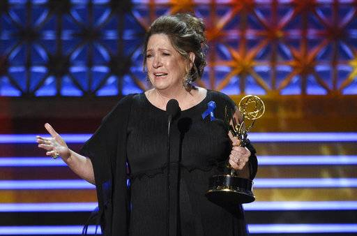 "Ann Dowd accepts the award for outstanding supporting actress in a drama series for ""The Handmaid's Tale"" at the 69th Primetime Emmy Awards on Sunday, Sept. 17, 2017, at the Microsoft Theater in Los Angeles. (Photo by Chris Pizzello/Invision/AP)"