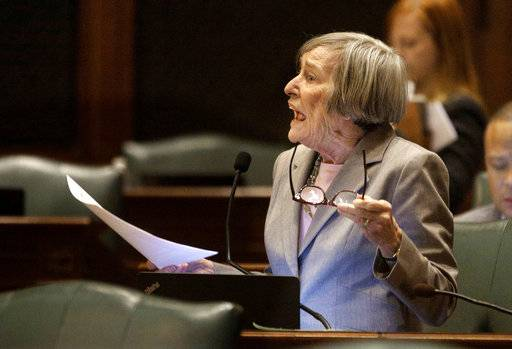 FILE -In this Dec. 2, 2015, file photo, Illinois state Rep. Barbara Flynn Currie, D-Chicago, speaks on the House floor at the Capitol in Springfield, Ill. More than two-dozen legislators, about 15 percent of the General Assembly, have either resigned months into the current session or said they won't seek re-election. House Majority Leader Currie said that she's ending her nearly 40-year legislative career when her term expires.