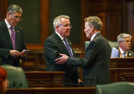 "FILE -In this July 6, 2017 file photo, Illinois State Rep. Steve Andersson, R-Geneva, center, shakes hands with Illinois Speaker of the House Michael Madigan, D-Chicago, right, at the Illinois State Capitol, in Springfield, Ill. More than two-dozen legislators, about 15 percent of the General Assembly, have either resigned months into the current session or said they won't seek re-election. Retiring Rep. Andersson says it's ""a toxic environment."" (Justin L. Fowler /The State Journal-Register via AP File)"