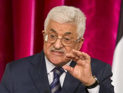 FILE - In this Sept. 19, 2014 file photo, Palestinian President Mahmoud Abbas gestures as he speaks during a media conference at the Elysee Palace in Paris. The Hamas militant group on Sunday, Sept. 7, 2017, said it has accepted key conditions demanded by its rival, President Mahmoud Abbas, including nationwide elections in the West Bank and Gaza Strip, to clear the way for a reconciliation deal after a 10-year rift that has left the Palestinians divided between two governments. (AP Photo/Michel Euler, File)