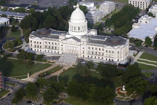 "FILE - This May 29, 2015 file photo shows the Arkansas state Capitol building in Little Rock, Ark. In February 2017, Arkansas lawmakers marked the 50-year anniversary of the Freedom of Information Act with a resolution calling it ""a shining example of open government� that had ensured access to vital public records for generations. They spent the following weeks debating and, in many cases approving, new exemptions to the law in what critics called an unprecedented attack on the public's right to know. (AP Photo/Danny Johnston)"