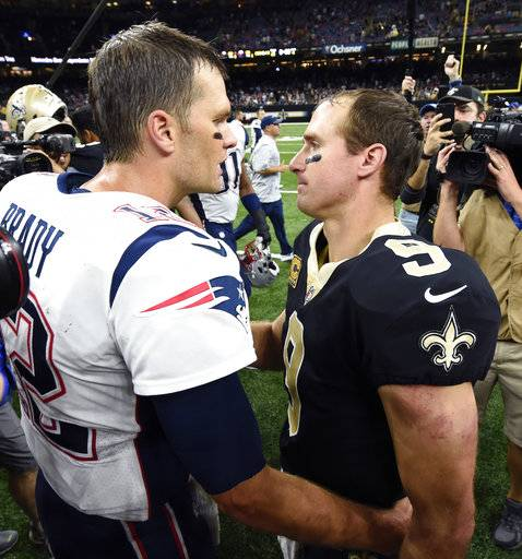 New England Patriots quarterback Tom Brady greets New Orleans Saints quarterback Drew Brees (9) after an NFL football game in New Orleans, Sunday, Sept. 17, 2017. The Patriots won 36-20. (AP Photo/Bill Feig)