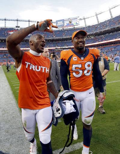Denver Broncos outside linebacker Von Miller (58) and Denver Broncos cornerback Aqib Talib leave the field after an NFL football game against the Dallas Cowboys, Sunday, Sept. 17, 2017, in Denver. The Broncos won 42-17. (AP Photo/Jack Dempsey)