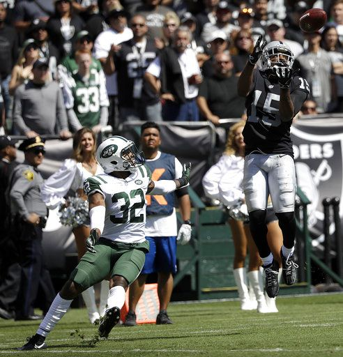 844c155ecf0 Oakland Raiders wide receiver Michael Crabtree (15) catches a touchdown  pass against New York