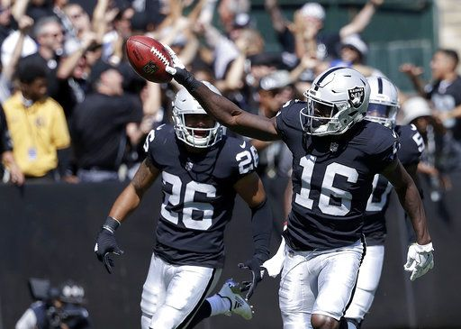 7ae2f7deda6 Oakland Raiders  Johnny Holton (16) celebrates after recovering a fumble by New  York