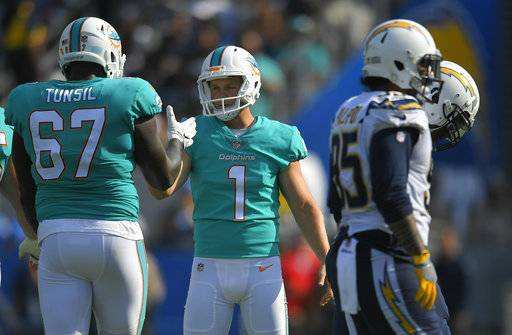 Miami Dolphins kicker Cody Parkey (1) celebrates with teammate offensive guard Laremy Tunsil (67) after booting a field goal during the second half of an NFL football game against the Los Angeles Chargers Sunday, Sept. 17, 2017, in Carson, Calif. (AP Photo/Mark J. Terrill)