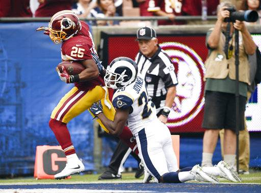 Washington Redskins running back Chris Thompson, left, scores past Los Angeles Rams free safety Lamarcus Joyner during the first half of an NFL football game Sunday, Sept. 17, 2017, in Los Angeles. (AP Photo/Kelvin Kuo)