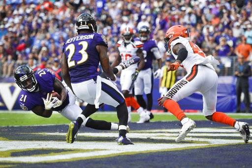 Baltimore Ravens free safety Lardarius Webb (21) intercepts a pass intended for Cleveland Browns Rashard Higgins (81) during the second half of an NFL football game in Baltimore, Sunday, Sept. 17, 2017. (AP Photo/Nick Wass)
