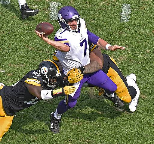 Minnesota Vikings quarterback Case Keenum (7) gets off a pass while being hit by Pittsburgh Steelers defensive end Tyson Alualu, rear, and outside linebacker Arthur Moats (55) during the second half of an NFL football game in Pittsburgh, Sunday, Sept. 17, 2017. (AP Photo/Don Wright)
