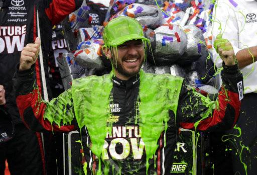 Martin Truex Jr. celebrates with his crew in Victory Lane after winning a NASCAR Cup Monster Energy Series auto race at Chicagoland Speedway in Joliet, Ill., Sunday, Sept. 17, 2017. (AP Photo/Nam Y. Huh)