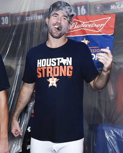 Houston Astros' Justin Verlander celebrates the team's win over the Seattle Mariners and clinching of the AL West crown in a baseball game, Sunday, Sept. 17, 2017, in Houston. (AP Photo/Eric Christian Smith)