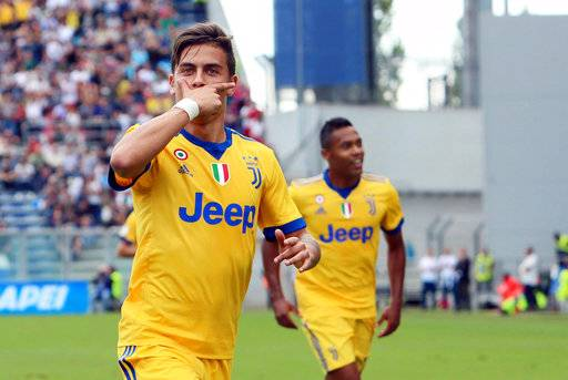 Juventus' Paulo Dybala celebrates after scoring during a Serie A soccer match between Sassuolo and Juventus, at Mapei Stadium in Reggio Emilia, Italy, Sept. 17, 2017.(Elisabetta Baracchi/ANSA via AP)