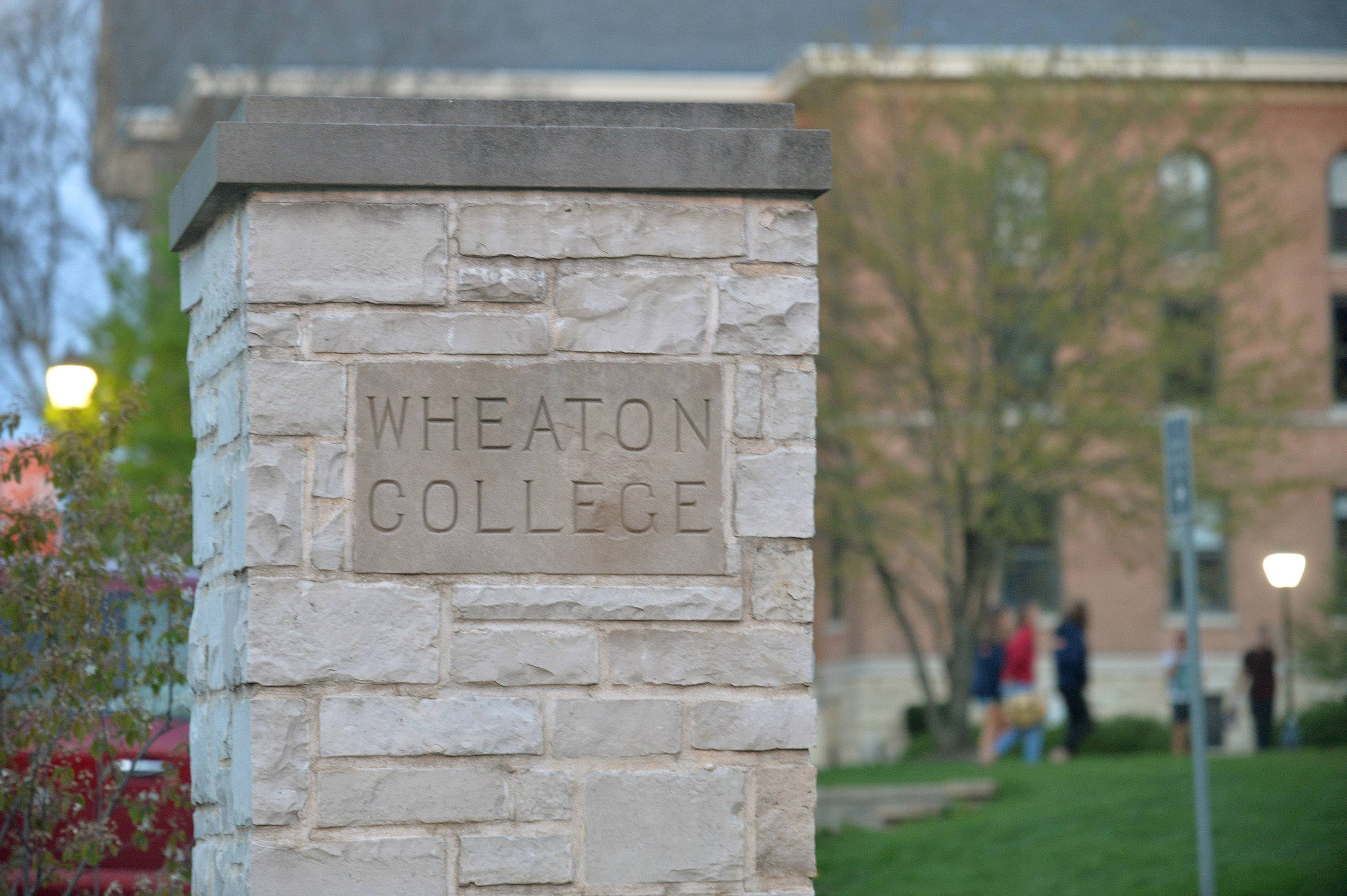 Five Wheaton College football players are facing charges in connection with a 2016 hazing incident.