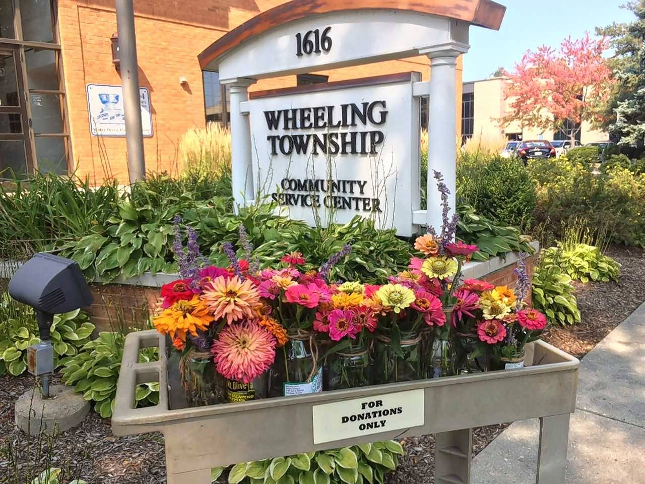 "One of the beds in the Viatorian Community's garden is devoted to flowers, and each week members bring in small bouquets to the township, which are given to Meals on Wheels recipients. One of the Viatorians described the flowers as ""food for the soul."""