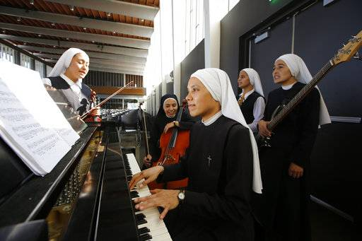 "In this Thursday, Sept. 7, 2017, photo members of ""Siervas,"" a Peruvian-based rock 'n' roll band comprised entirely of Catholic nuns rehearse a day ahead of their performance at performance at the Christ Cathedral campus in Garden Grove, Calif. The sisters insist they aren't rock stars though they're being considered for a nomination for a Latin Grammy and their concerts draw thousands."