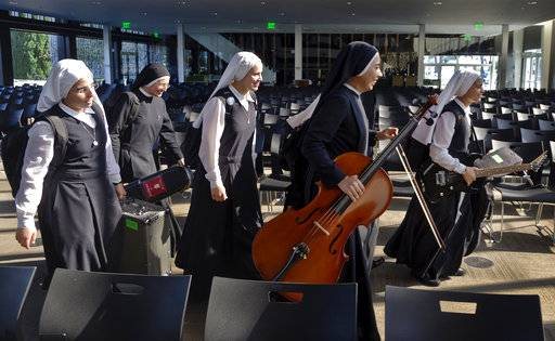 "In this Thursday, Sept. 7, 2017, photo members of ""Siervas,"" a Peruvian-based rock 'n' roll band comprised entirely of Catholic nuns rehearse a day ahead of their performance at performance at the Christ Cathedral campus in Garden Grove, Calif. The band was born in a convent three years ago and since has gained an international following drawn by their smiling faces and soaring songs."