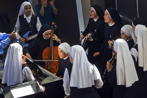 "In this Thursday, Sept. 7, 2017, photo members of ""Siervas,"" a Peruvian-based rock 'n' roll band comprised entirely of Catholic nuns rehearse a day ahead of their performance at the Christ Cathedral campus in Garden Grove, Calif. The sisters insist they aren't rock stars though they're being considered for a nomination for a Latin Grammy and their concerts draw thousands."