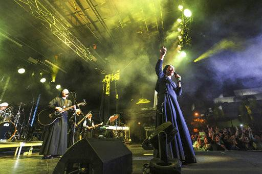 "In this Friday, Sept. 8, 2017, photo provided by Diocese of Orange, ""Siervas,"" a nun rock band performs live at the Festival de Cristo at Christ Cathedral in Garden Grove, Calif. The band known as Siervas was born in a Peruvian convent three years ago and since has gained an international following drawn by their smiling faces and soaring songs. (Challenge Roddie/Diocese of Orange via AP)"