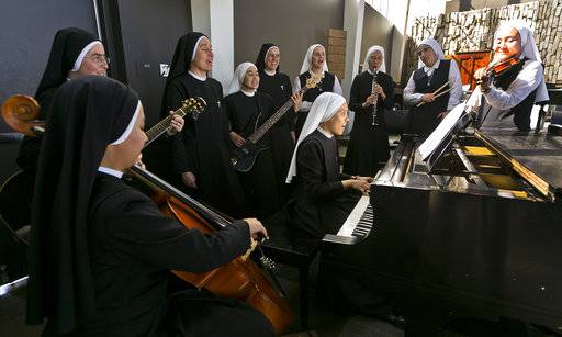 "In this Thursday, Sept. 7, 2017, photo members of ""Siervas,"" a Peruvian-based rock 'n' roll band comprised entirely of Catholic nuns rehearse a day ahead of their performance at performance at the Christ Cathedral campus in Garden Grove, Calif. Their songs of love and faith have earned over a million YouTube views, led to the release of two CDs and now they are waiting to see if they are among the honorees when Latin Grammy nominations are announced Wednesday, Sept. 20."